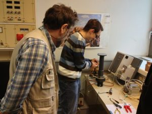 Mr. Roman Koller and Dr. Johann Laimer at work installing the plasma reactor